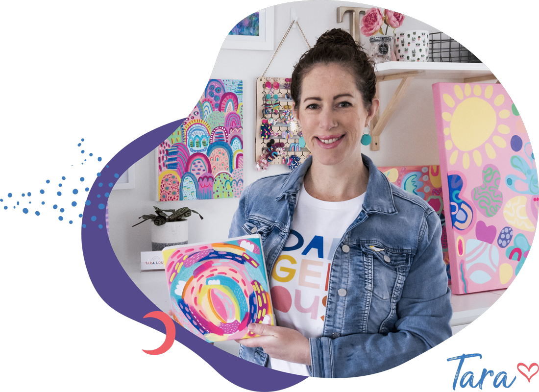 Artist Tara in her studio with abstract art canvas